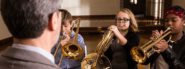 children playing brass instruments