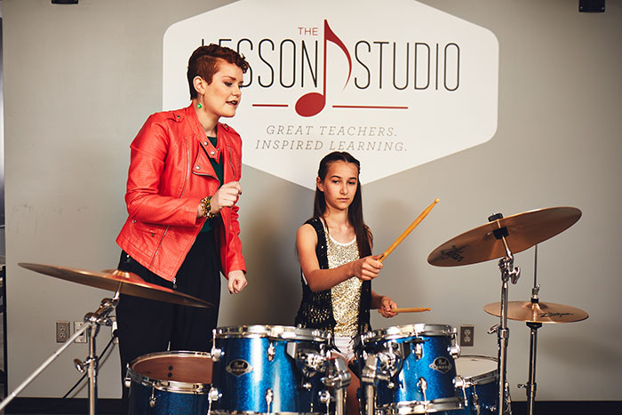drum teacher with student